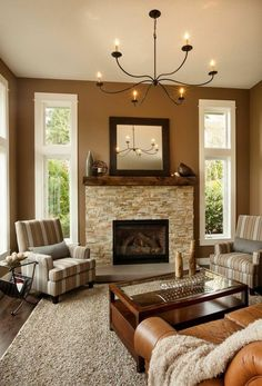 Traditional Living Room With Chandelier, Safavieh Cozy Beige Shag Area Rug,  High Ceiling, Stone Fireplace, Hardwood Floors