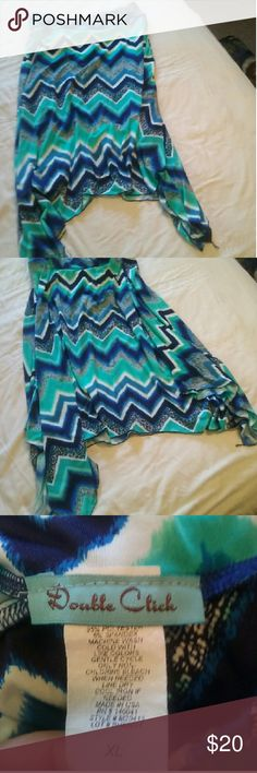 High low women's skirt Gorgeous hues of blues and teals with  white and black accents make this skirt a head turner! It's longer on the sides and has a great silky cool material. Like new condition Double Click  Skirts High Low
