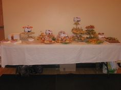 One of the food tables.The tiered dishes all made from dollar store and second hand store dishes.