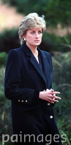 February 7, 1995: Princess Diana walks through the Hodogava war cemetery, Tokyo, on the first full day of her four-day visit to Japan. The cemetery contains the graves of those who died in Japanese prisoner-of-war camps.