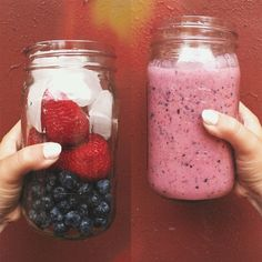 Strawberries, yogurt, ice, blueberries, honey, & a little bit of oats to fill you up.