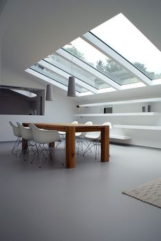Minimalist modern space with skylights