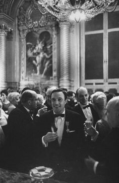 Not originally published in LIFE. Gene Kelly enjoys himself at a party following the triumphant premiere of his ballet, Pas de Dieux (Dance of the Gods), at the Paris Opera, 1960.