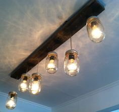 How to make a lighting fixture out of mason jars pendant lighting improve your rooms with contemporary rustic track lighting fixtures western styles are looking elegant with a warm and inviting atmosphere mason jar aloadofball Images