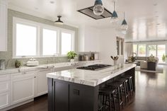 MATERIALS/FLOOR: Walnut floor /WALL: Green subway tiles and level five smooth/LIGHTS: Lucifer Can and pendant lights /CEILING: smooth ceilings /TRIM: Crown molding, base board, and window casing/ APPLIANCES: Thermador appliances and Sub-Zero fridge/