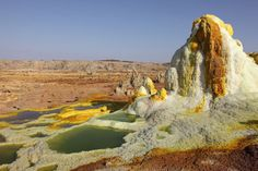Dallol - The World's Weirdest Volcanic Crater                In the North East of Ethiopia lies the Danokil Desert.  At its heart is a volcanic crater, Dallol, little known and seldom visited but quite extraordinary.                  Surrounding the volcano are acidic hot springs, mountains of sulphur, pillars of salt, small gas geysers and pools of acid isolated by salt ridges. It makes for one of the most bizarre landscapes on planet Earth.