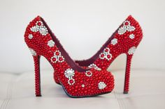 What do you think?   Red Bridal Shoes with Pearls and Rhinestones by goldsole on Etsy.