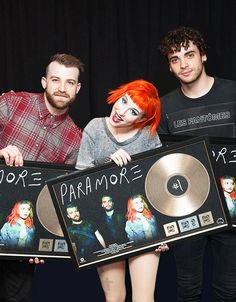 Paramore with their awards for the Self Titled album and Still Into You from the Australian Recording Industry Association - from tumblr