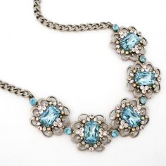 Sorrelli Sky Blue Peach Collection. Statement necklace, scroll design, Indian Sapphire crystals. Love this piece for bridal, formal affairs or with jeans.