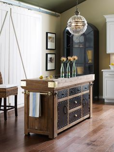 Belmont collection takes its cue from the grand hotels and mansions of a bygone era. Handcrafted of solid Acacia wood with champagne finish. Belmont Medium Kitchen Island is crafted with...