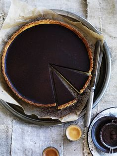 I love dark chocolate, th higher the cocoa percentage the happier I am. So a bittersweet chocolate tart? Ingredients Serves 8 to 12 plain flour unsalted butter, cubed Pinch sea s. Köstliche Desserts, Chocolate Desserts, Dessert Recipes, Chocolate Torte, Gula, Sweet Pie, How Sweet Eats, Let Them Eat Cake, Love Food