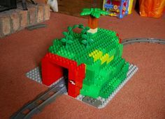Lego duplo tunnel to put over our train tracks Walt Disney, Lego Disney, Disney Pins, Lego Duplo Train, Lego Trains, Lego Club, Lego Design, Best Lego Sets, Lego Challenge