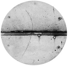 Carl D. Anderson, Positive Electron, (1933)  Cloud chamber photograph of the first positive electron (positron) ever observed. A 63 million volt positron (Hρ = 2.1×105 gauss-cm) passing through a 6 mm lead plate and emerging as a 23 million volt positron (Hρ = 7.5×104 gauss-cm). The length of this latter path is at least ten times greater than the possible length of a proton path of this curvature.