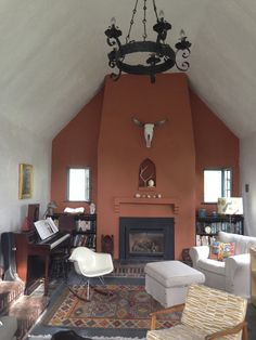 Newly painted orange wall, Eames chair, and skull in the living room.