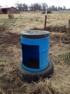 DIY Mineral Feeder made from old barrel and tire. We made these for use around our farm. We made 3 of them and have abt $60 in all 3. Goat Hay Feeder, Feeder Cattle, Horse Slow Feeder, Sheep Feeders, Horse Barns, Horses, Farm Hacks, Livestock Farming, The Barnyard