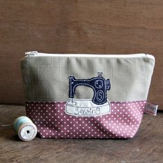 Our lovely sewing machine make up bag is the perfect home for your cosmetics or your sewing kit! With its navy stitched singer sewing machine on the front, and fully lined with a matching navy splash proof lining, this classic design is just the thing for your favourite crafty friend. Handmade by our little team in Cornwall.