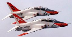 Two Plane Formation Flight – A T-45 from Training Air Wing TWO flies above a T-45 from Training Air Wing ONE at NAS Meridian, MS over the skies of Kingsville during a routine training flight.