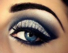Smokey eye makeup- shimmery silver, black and blue with winged eyeliner [with this much drama, best with nude lips]