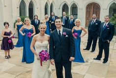 Vibrant hot pink and purple bouquets are a pretty accent to blue bridesmaid dresses. Photo: Joie du Jour Photography