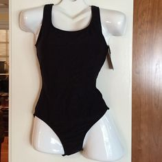 Cherokee tummy toning one piece blk tank size 8 Tummy toning Cherokee brand one piece blk bathing suit size 8. Cherokee Swim One Pieces