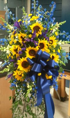 Standing Funeral Spray in blue and yellow with iris, sunflowers, Delphinium and larkspur Casket Flowers, Grave Flowers, Cemetery Flowers, Funeral Flowers, Silk Flowers, Funeral Floral Arrangements, Sunflower Arrangements, Funeral Caskets, Funeral Sprays