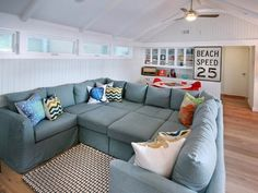 Add two ottomans to a sectional to create a huge couch (Big Blue Couch from Gold & Pitt)