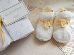 A personal favourite from my Etsy shop https://www.etsy.com/uk/listing/263959156/hand-knitted-baby-booties-in-white-new