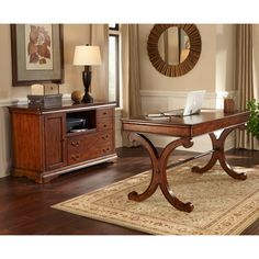 This home office set will turn any spare corner into a small, functional office. The rustic cherry finish gives the writing desk and mobile credenza a warm, inviting look that will complement any modern or traditional living space.