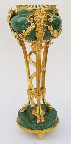 A Fine and Large Pair of French 19th Century Napoleon III Figural Gilt-Bronze and Malachite Veneered Jardinières, after the model by Pierre Gouthière (French, 1740-1806).