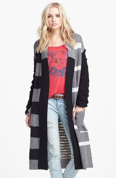 Free shipping and returns on Free People Floral Pattern Detail Cardigan at Nordstrom.com. Bold variegated stripes and ribbed edges lend graphic dimension to a sweeping midi-length cardigan softened with plush open-stitch sleeves and a pixelated floral pattern in back.