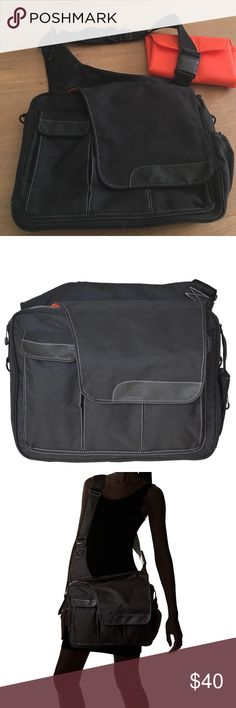 Diaper Dude Black and orange diaper bag Awesome diaper bag for dad (or mom!). Tons of compartments for absolutely everything a baby needs. Easy to clean, padding on back for hip support, includes changing mat. Great overall condition, please see photos for wear and tear on front flaps. Diaper Dude Bags Baby Bags