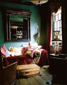 Cosy boho bohemian chic living space. Lots of velvet, mixed colours and patterns and textures.