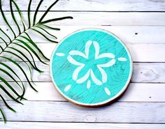 Our Tropical Sand Dollar Cut-Out is perfect for your home. Hand cut into the shape of a Sand Dollar, sanded, hand-painted using up-cycled wood, and then dried on our lanai by the Hawaiian Sun. Aloha is more than an inspiration for our designs, its our way of life. We are influenced by Hawaii and the people that live here on the islands.  No two pieces are exactly alike, each one is unique and we like it that way. Choose from the designs that are already available or you may make requests in…