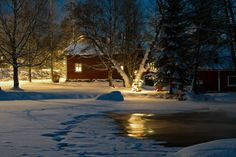 Talvi - Mikko Lönnberg Photography. Home by the lake in Finland in winter.