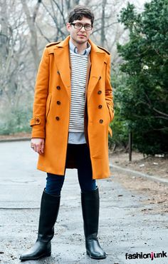 Orange overcoat, nautical striped crewneck sweater, jeans and black rain boots