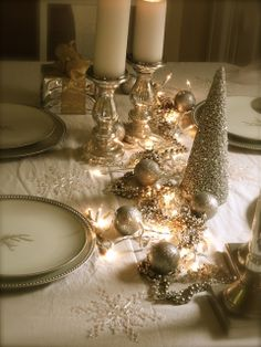 I love the way the small lights are on teh table. Very cozy.  HouseTalkN: All That Glitters...