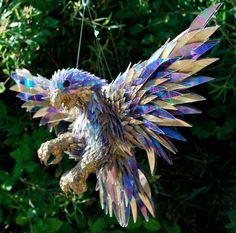A Furious Falcon by Sean Avery. Sculpture made from broken CDs.