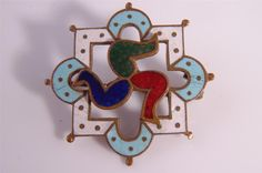 ENAMEL ISLE OF MAN TRISKELION BROOCH
