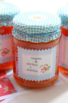 Jam jars covered with cupcake liners and a matching label