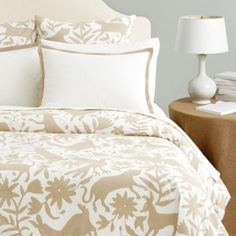 The playful pattern of whimsical animals and flowers in this colorful Duvet Cover was inspired by the traditional Otomi embroidery of Mexico. Printed on soft cotton-linen blend with solid white reverse.