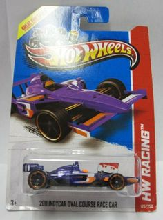 Hot Wheels 2013 HW Racing 2011 INDYCAR OVAL COURSE RACE CAR - Track Aces - 126/250 1:64 scale by Mattel. $1.66. Hot Wheels 2013 2011 Indycar Oval Course Race Car. HW Racing - Track Aces series 126/250. 1:64 scale. Purple with orange and white detail. Hot Wheels 2013 2011 Indycar Oval Course Race Car. HW Racing - Track Aces series. #126/250, 1:64 scale.