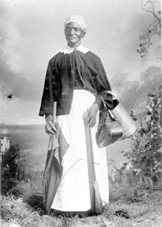 """AUNT MEMORY"" ADAMS, was born into Slavery. When she was twenty-four years old she was taken to Tallahassee and sold to Mr. Argyle for $800. Aunt Memory attended the 1893 World Fair, and sold enough photos of herself to pay for expenses. ca. 1900. Image: Aunt Memory Adams posed for a photo - Tallahassee, Florida.  (State Archives of Florida)"