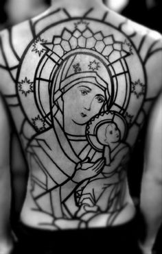 Although it's not for me, the idea of a stained glass effect tattoo done as well as this looks awesome. Love the strong lines.