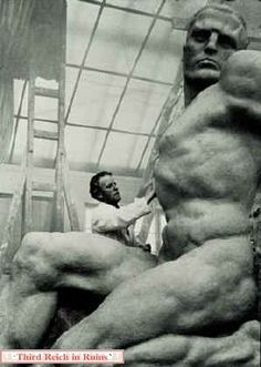 """Thorak's works were often monumental, particularly those meant to grace the autobahns and the Nazi Party Rally Grounds in Nürnberg, so his studio had to be very large. The photo on the left shows Thorak working on an autobahn sculpture called """"Monument to Work."""""""