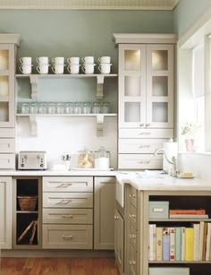 Hi Again, You guys have been so helpful with your ideas and suggestions, I'm wondering if you can help me with this. I am in the process of buying a small, older home on a lake. This is the current kitchen. I would like to redecorate the whole house to have more of a cottage, beachy feel and this ki...
