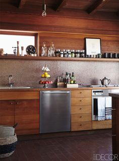 In fashion designer Rozae Nichols' Los Angeles kitchen, redwood cabinetry adds a touch of rustic-chic to the transformed midcentury California home.