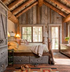 cozy attic bedroom, exposed beams! Also love the storage bed, smart!
