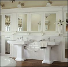 Storage above pedestal sink, and to the left and right or the sink in the wall