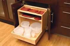 Plastic containers often mysteriously become separated from their lids too. A couple of internal shelves make for a tidy solution. Instead of throwing containers of every shape and size into this drawer, save similar containers that fit into one another and stack them neatly in separate piles.