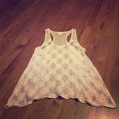 Anthropologie Lace Tank Beautiful lace racer back tank. Wear it layered or over your swimwear. Excellent condition. Cotton/nylon blend. Brand is Deletta, purchased at Anthropologie. Deletta Tops Tank Tops